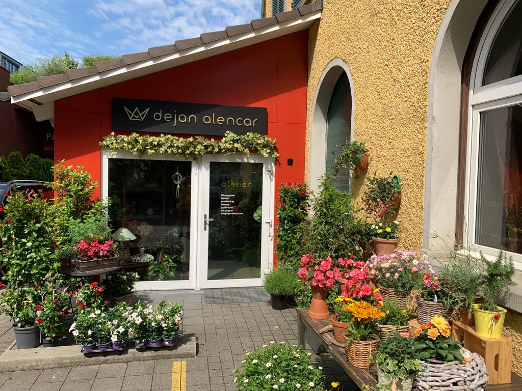 Flower Shop Studio entrance shot with lots of beautiful flowers arranged all over